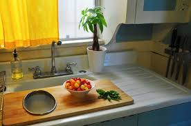 sink covers for more counter space create counter space over the sink cutting boards kitchn