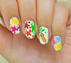 flaunt this easy colourful holi themed nail art this season