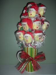 santa claus cake pops i made for my husbands employers christmas