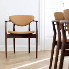 scandinavian design chair upholstered with armrests walnut