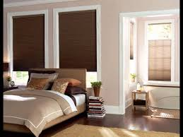 decorating white window with brown wooden levolor blinds on cream