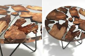 this amazing resin table is made using 50 000 year old wood