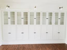 furniture home white bookcase with glass doors on brown wodden