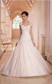 blush wedding dress with sleeves wedding corners