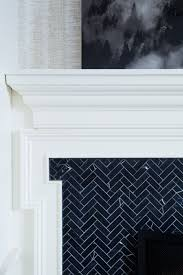 dark chevron tile on this fireplace design the curated house