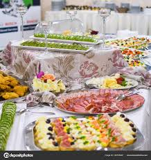table full of food buffet table full of food in small dishes sweets and a fruit