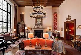exposed wood frame sofa eclectic living room with exposed beam by the corcoran group
