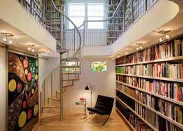 interior design bright home library with steel spiral staircase