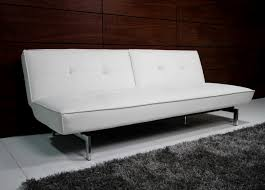 white faux leather couch with metal legs on white ceramic tiled