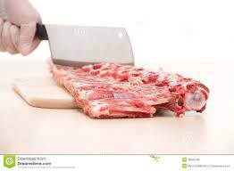 single large butcher knife on cutting board stock photo image