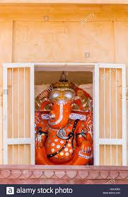 a temple shrine housing a deity of the hindu god ganesh at