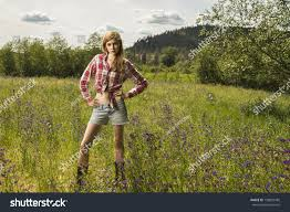 beautiful young posing outdoors grassy stock photo 198825482