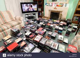 a large dvd collection of dvds of and tv with a large screen