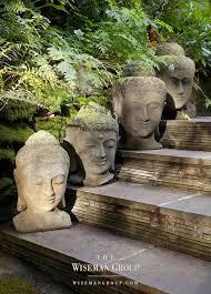 buddha heads on each step what an interesting garden