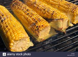 Outdoor Barbecue Fresh Yellow Corn Grilling On An Outdoor Barbecue Stock Photo