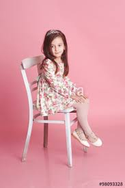 dress pattern 5 year old cute baby girl 4 5 year old sitting on white chair over pink in room