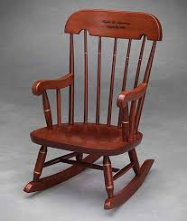 Rocking In A Rocking Chair Either Yourself Or Rocking A Child A - Wooden rocking chair designs