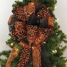 a brown christmas tree christmas tree topper bows package bows