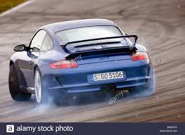 porsche 911 back porsche 911 gt3 model year 2006 blue moving diagonal from the