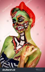 halloween portrait background portrait pinup zombie woman over pink stock photo 483913195