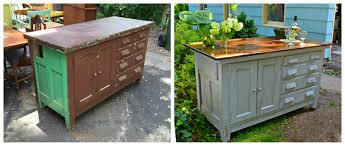 heir and space an antique work bench turned kitchen island i stained the top in dark walnut and sealed it glossy smooth i painted the case in a soft gray with a mocha colored interior to the cupboard and drawers