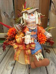 fall scarecrow bushel basket with pumpkins fall arrangement