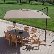 Square Patio Table by Square Offset Patio Umbrella Over Patio Table And Chairs Set And