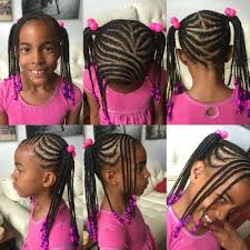 kids braided hairstyle braided into two ponytails with bangs and