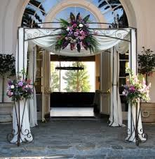 wedding arches rental in orlando fl iron chuppah with draping flower and 2 stand with flowers all