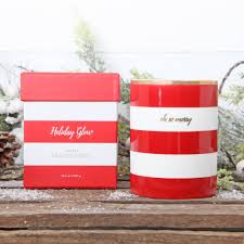 fraser fir scented candle in red and white pot by red berry apple