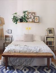 versatile bedroom decor shelves above the bed apartment therapy