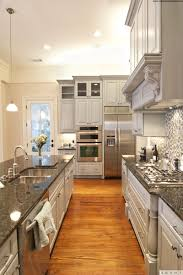 Large Galley Kitchen Kitchen Style Black Ceramic Tile Stainless Countertops Modern