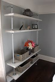 grey rustic diy shelf made from metal plumbing pipes and wood