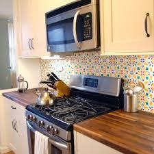 stunning wallpaper backsplash behind stove images design