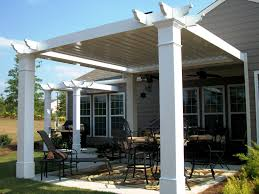 exterior white pergola attached to house with cover roofing on