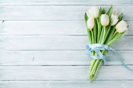 white tulips white tulips bouquet on wooden background top view with space