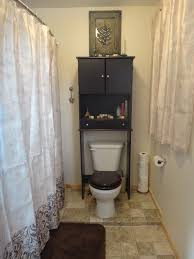 freestanding black wood over toilet cabinet with shelf and double