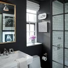 white and gold bathroom with black and white striped floors