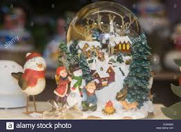 snow globe and robin ornaments stock photo royalty free