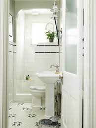 white bath up combined wth red cream floral curtains combined with bathroom white sink and toilet on the white floral flooring plus white tile shower