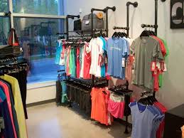 furniture fancy clothing racks on wall for clothing store with