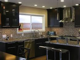 painting kitchen cabinets espresso before and after espresso painted kitchen cabinets