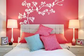charming red bedroom design idea with red wall paint color and