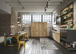 contemporary industrial kitchen features light wood kitchen
