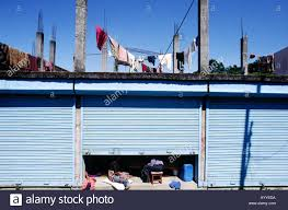 blue metal roller door garage style with nepalese family inside