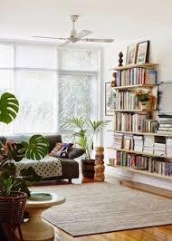 bookshelves in living room the renovated living room manhattan nest side wall shelves and