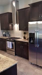 limestone countertops dark brown kitchen cabinets lighting