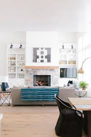 open living space with natural light and tufted teal ottoman