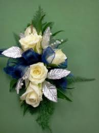 royal blue corsage white spray silver leaves royal blue ribbon wrist corsage in