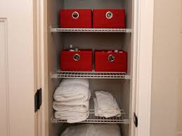 interior bathroom linen closet and cabinet with wood color and